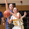 Greenbrier East's Brooke Davis gets past Princeton's (20) during Tuesday's game at Greenbrier East High School in Fairlea. Jenny Harnish for the Register-Herald