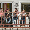 A group of youths enjoy their scoops of ice cream in front of the Frozen Barn in east Oak Hill. F. Brian Ferguson/for The Register-herald