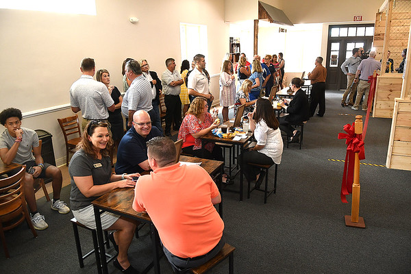 People having lunch at the Axe Hole on 328 Neville Street in Beckley.<br /> (Rick Barbero/The Register-Herald)