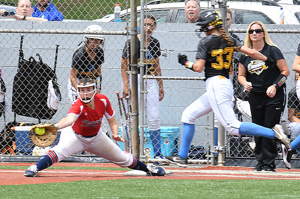 Chloe Hart, of Independence, stretches to get Makayla Zoellers, of Oak Glen, out at first base during the Class AA Girls State Softball Tournament held at Little Creek Park in South Charleston.<br /> (Rick Barbero/The Register-Herald)