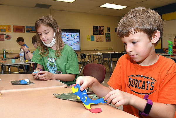 McKinley Gross, left, making a whale and Eli Payne makes a shark during the STEM Camp held at Summers Co. High School.<br /> (Rick Barbero/The Register-Herald)