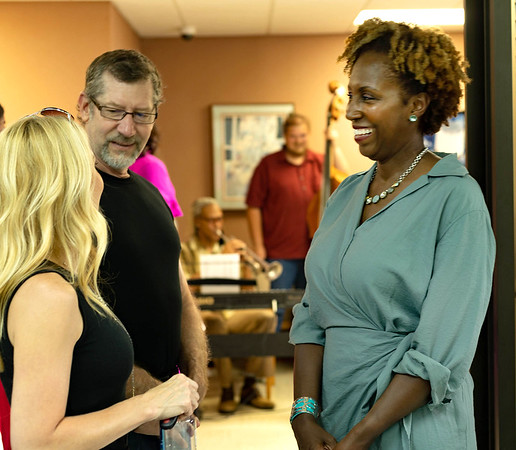 Owner Elizabeth Thompson Nelson, MD greeting friends at her open house, James and Rebecca Paine.<br /> Tina Laney/for The Register-Herald