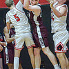 Oak Hill's Samuel Crist, left, and Camden Craddock, right, defend as Woodrow Wilson's Ben Gilliam pulls down a rebound during Thursday action in Oak Hill. F. Brian Ferguson