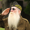 Jerry Malone, Chaplin of VFW Post 4326,  salutes the flag during a Memorial Day service held in Coal City. Jon C. Hancock/for The Register-Herald