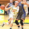 Greenbrier East's Cadence Stewart pushes past Princeton's Lauren Parish during Tuesday's game at Greenbrier East High School in Fairlea. Jenny Harnish for the Register-Herald