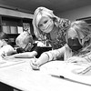 Katie Cooper, 3rd grade teacher Crescent Elementary School, third from left, work with her student, Ali Radford, left, Tuesday morning during the first day of school in Raleigh County.<br /> (Rick Barbero/The Register-Herald)