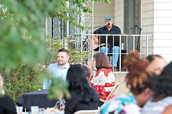 Jim Snyder plays at Business After Hours at the Beckley Woman's Club Thursday. The Beckley Concert Association  teamed up with Business After Hours to introduce people to the series, which is back after being shut down last year because of COVID. Jenny Harnish/The Register-Herald