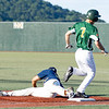 Denver Blinn for the WV Miners beats the throw to the stretching first base Miguel Rivera for the Lafayette Aviators.<br /> Tina Laney/for The Register-Herald