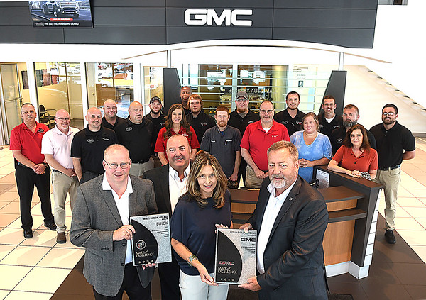 Beckley GMC Auto Mall won the 2020 General Motors Mark of Excellence Award. This is GMC most prestigious award and Beckley Auto Mall was one of only two dealership in the State of West Virginia to receive it. Presenting the award from right, Nick Klein, district sales manager Buick GMC, to Rick Lewis, general manager, left. Ernie Davis, owner, Lori Davis, owner.<br /> (Rick Barbero/The Register-Herald)
