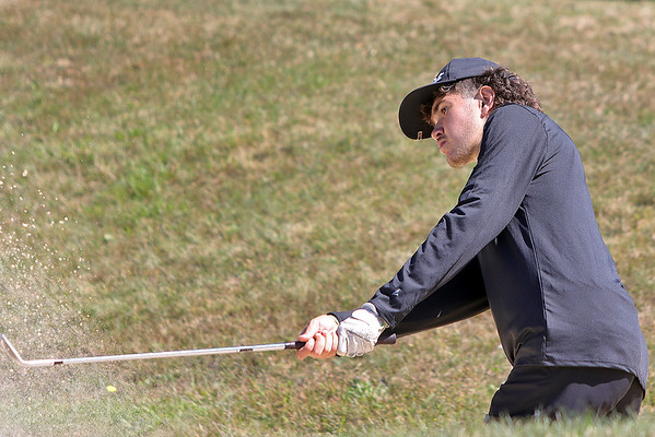 Riverview's Caleb Kennedy looks after his shot during the Class A Region 3 golf tournament at Pipestem Resort State Park Monday. Jenny Harnish/The Register-Herald