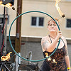 Tori Lilly of Shady Spring Plays wiith fire during the Beer festival Sunday evening in Beckely.<br /> Tina Laney/for The Register-Herald