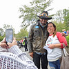 NASCAR's Richard Petty poses with fan Sarah Burgess during a stop at the Canyon Rim Visitor Center Thursday. The Kyle Petty Charity Ride Revival is reuniting riders after more than two years apart due to the COVID-19 pandemic. The organization raises funds for Victory Junction and other charities that support chronically ill children.  Jenny Harnish/The Register-Herald
