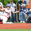 Alyvia Pittman, of Ritchie County, right, tags out  Chezney Skaggs, of Midland Trail during the Class A State Softball Tournament held at Little Creek Park in South Charleston.<br /> (Rick Barbero/The Register-Herald)
