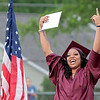 Jamara Walton celebrates after receiving her diploma from Woodrow Wilson High School at the 95th annual commencement ceremony in Beckley Saturday.  Jenny Harnish for the Register-Herald
