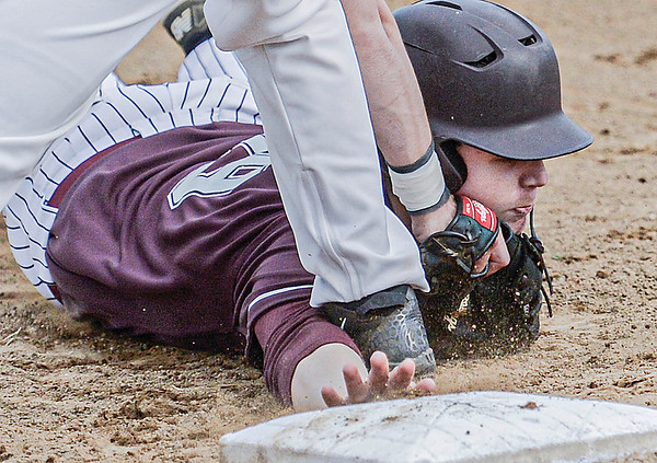 F. Brian Ferguson/Register-Herald  Woodrow Wilson's Danny Dickerson is picked off at first base as Oak Hill's Jacob Ward during Tuesday action in Oak Hill.