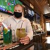 Mason Martinez, bartender Campestre on Harper Road, puts together thier Trash Can and Lime House Margarita beverages.<br /> (Rick Barbero/The Register-Herald)