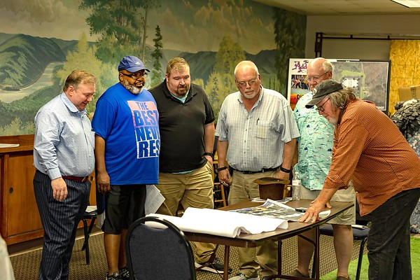 Steve New, past presidenrt left, Phil Copney, Sam Breckenridge, Keith Thompson, Rick Snuffer, board members and Scot Hill, general manager, look over architectural drawning of a possible new home for Theatre West Virginia.<br /> (Tina Laney/For The Register-Herald)