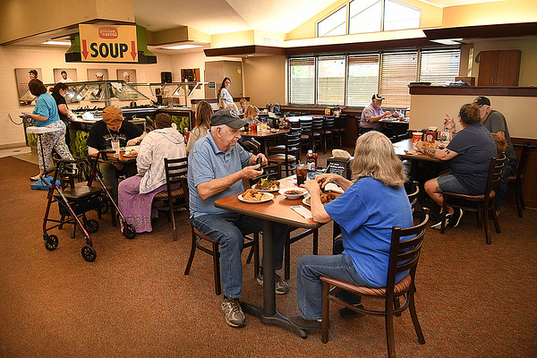 Customers eating at the Goden Coral in Beckley.<br /> (Rick Barbero/THe Register-Herald)