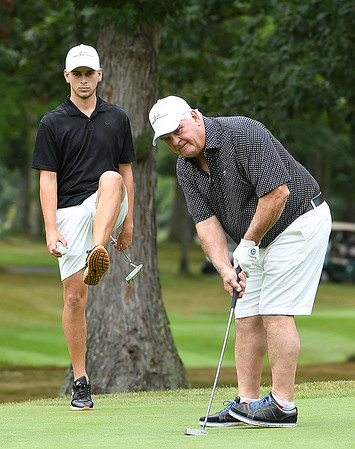Landon Perry, left, reacts after Jim Hern just missing a birdie putt on the par 4, 4th hole during the Eighth Annual Golfing for Scholars scramble held on the Cobb Coarse at The Resort at Glade Springs. <br /> (Rick Barbero/The Register-Herald)