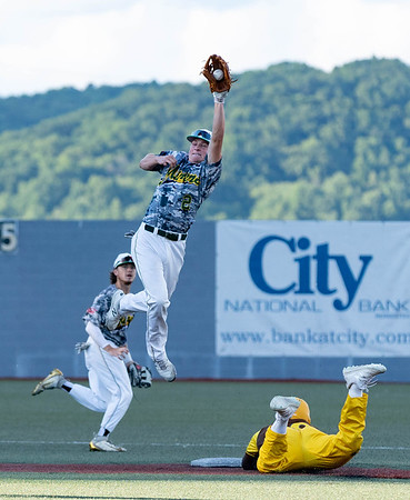 DJ Alexander with the Johnstown Mill Rats easily steals  2nd base as Miners Brendan Williams jumps to catch the ball.<br /> Tina Laney/for The Register-Herald