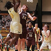 Greenbrier East's Quentin Wilson tries to get the ball past Woodrow Wilson's Ben Gilliam during Tuesday's game at Greenbrier East in Fairlea.  Jenny Harnish for the Register-Herald