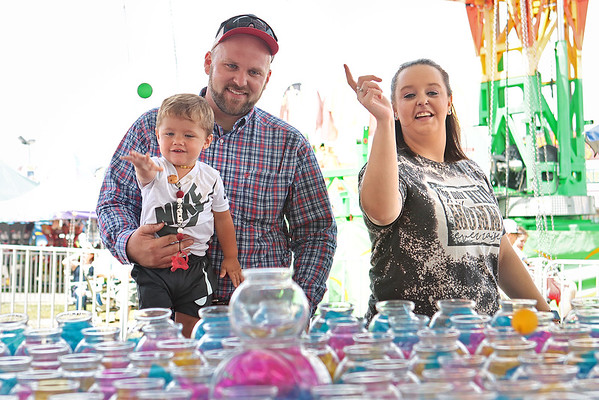 Bryce Case plays ball for a fish with his parents Chris Case and Brittany Case at the State Fair of West Virginia Wednesday in Fairlea. Jenny Harnish/The Register-Herald