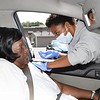 Vinnie Hick's, of Mt. Hope, receives a COVID-19 vaccination from Zelda Pushkin, certifield medical assistant for Partnership of African American Churches Surge testing and vaccination team that was held at the Heart of God Ministries on 1709 South Kanawha Street in Beckley Thursday morning.