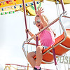 Vada Bloom, 4, of Charleston rides on a kids swing at the State Fair of West Virginia on opening day in Fairlea Thursday. Jenny Harnish/The Register-Herald