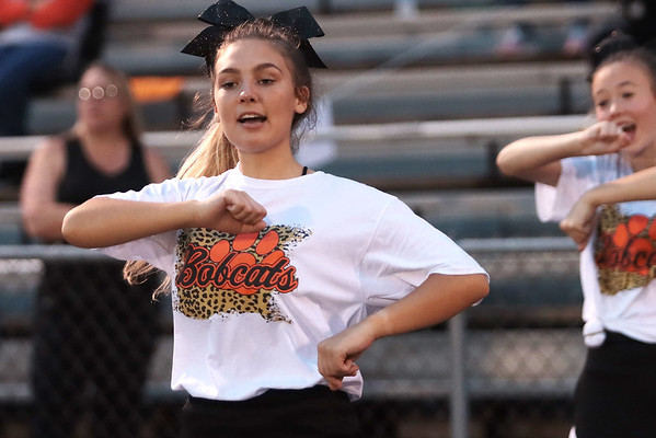 A cheerleader cheers during Thursday's game at Summer's County High School in Hinton. Jenny Harnish/The Register-Herald