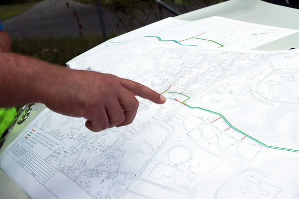 Beckley Sanitary Board Operations Manager John Peplowski, right, looks over plans to reestablish 3000 ft of stream to fix ongoing flooding problems. The work will start at Hunter Street and Bair Street and run to the Pine Crest Development Park. The work is slated to begin in spring 2022. Jenny Harnish/The Register-Herald