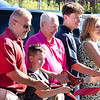 Trinity Motor Grand Opening,<br /> Scott Tystuck General Manager, Owner ET and Roberta Smith with the grandkids cutting the Ribbon.<br /> Tina Laney/for The Register-Herald
