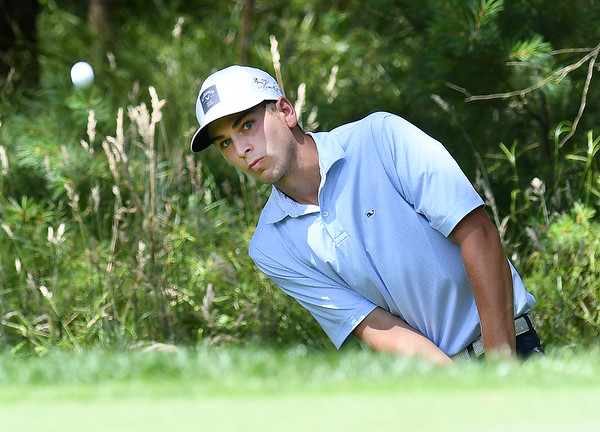 Landon Perry chips up on the par 3, 13th hole during the final round of the Mountain State Golf Classic held on the Cobb course Monday.<br /> (Rick Barbero/The Register-Herald)