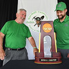 Larry Foster, treasurer, left, and Marshall assistant soccer coach, Kyle Sniatecki, look over the National Championship trophy displayed at Grandview Country Club during the Marshall University Southern Coalfields Alumni & Big Green Club 31st annual golf outing. <br /> (Rick Barbero/The Register-Herald)