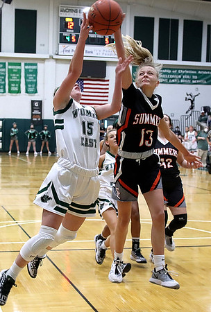 Madison Clark (Wyoming East) has a shot blocked by Sullivan Pivont (Summers County).