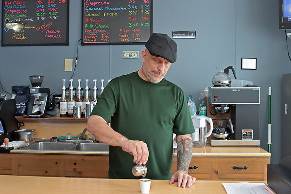 The Coal Bucket coffee shop owner Aubrey Dickerson pours an espresso at the newly reopened shop in Mt. Hope Thursday.  Jenny Harnish/The Register-Herald. Jenny Harnish/The Register-Herald