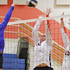 Summers County's Danielle Midkiff, left, and Maggie Stover guard the net against Montcalm during Thursday's game at Summers County High School in Hinton. Jenny Harnish/The Register-Herald
