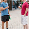 (left) Alex Shackley of Teays Valley and Zack McClaine of Crosslanes enjoy the Beer Festival Sunday eveing in Beckley.<br /> Tina Laney/for The Register-Herald