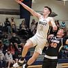 Greenbrier West's Kaiden Pack jumps for the basket past Richwood players during Tuesday's Class A Region 3, Section 1 tournament game at Greenbrier West High School in Charmco. Jenny Harnish for the Register-Herald