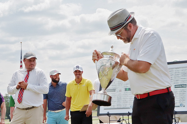 Philip Reale hold his trophy after winning the 102nd West Virginia Amateur on the Old White course at The Greenbrier in White Sulphur Springs Wednesday.   Jenny Harnish/ The Register-Herald