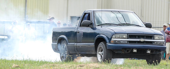 Michael Bailey making some smoke with his S10 Sonoma during the Burnout Contest at the Friends of Charity Auto Fair<br /> Tina Laney/for The Register-Herald