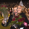 Jennifer Bair, left, hugs Mallory Daniel after she was crowned queen at halftime during the Woodrow Wilson vs Princeton game Friday night at VanMeter Stadium in Beckley.<br /> (Rick Barbero/The Register-Herald)