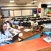 Kathy Neil 4th grade teacher at Maxwell Hill Elementary School preparing a letter to parents for the first day of school that starts Tuesday in Raleigh County.<br /> (Rick Barbero/The Register-Herald)