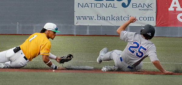 Brady Emerson for the Champion City Kings slides safely into 2nd base while Kenneth Melendez goes for the tag.<br /> Tina Laney/For the Register-Herald