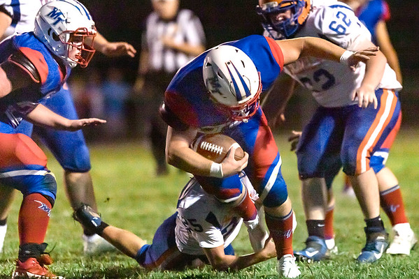 Midland Trail running back, Griffin Boggs barrells through the Tolsia defense. Chad Foreman for the Register-Herald.