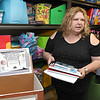Cindy Parker gathers material for Operation Backpack at Mabscott United Methodist Church.<br /> (Rick Barbero/The Register-Herald)