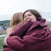 Caysee Diehl hugs Briana Scott after receiving their diplomas from Woodrow Wilson High School at the 95th annual commencement ceremony in Beckley Saturday.  Jenny Harnish for the Register-Herald
