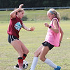 Woodrow Wilson soccer players Cecilia Lindley left, and Sophia Hall battle for the ball during practice Tuesday at the YMCA Paul Cline Memorial Youth Sports Complex. Jenny Harnish/The Register-Herald