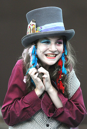 The Mad Hatter, played by Jamie Palmer, smirks devilishly during the tea party with Alice. Jon C. Hancock/for the Register-Herald