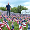 Rainelle town recorder and acting Mayor Bill Bell, looks over a field of flags put together by LZ Rainelle.  Over 11,000 American flags are on display in front of Rainelle Medical Center in memory of each West Virginia Soldier killed in action since WW I.  The flags will be on display May 20 – May 31, 2021. A candlelight is scheduled for Friday, May 28 at 730 p.m.  Jenny Harnish for the Register-Herald