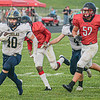 F. Brian Ferguson/Register-Herald Nicholas County's Kaleb Clark runs for a TD as Oak Hill's Max Underwood gives chase during Friday action in Oak Hill.
